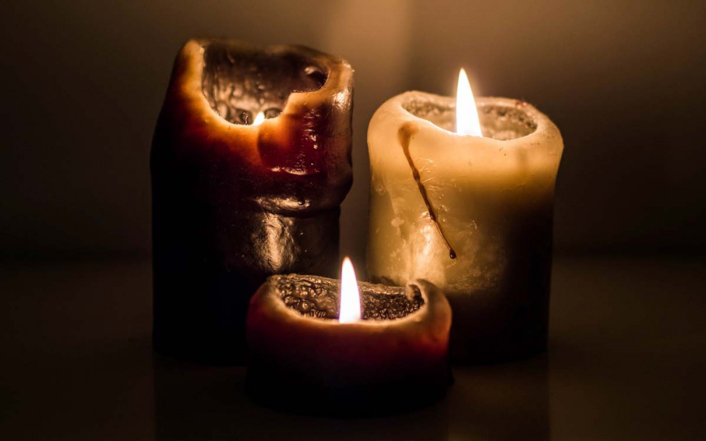 photograph of candles in low light