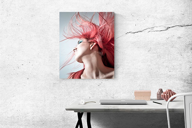 pink-haired woman canvas print hanging on white wall